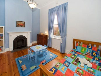 Children's room bedroom design idea with floorboards & fireplace using blue colours - Bedroom photo 526433