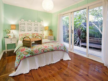 Country bedroom design idea with floorboards & floor-to-ceiling windows using green colours - Bedroom photo 523865
