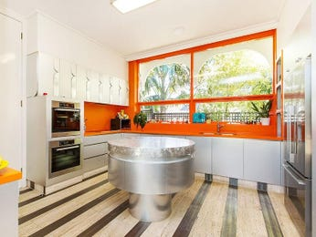 Retro l-shaped kitchen design using floorboards - Kitchen Photo 1602973