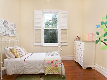 Children's room bedroom design idea with floorboards & sash windows using cream colours - Bedroom photo 524857