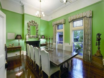 Formal dining room idea with floorboards & fireplace - Dining Room Photo 523129