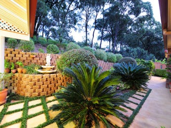 Landscaped garden design using brick with retaining wall & fountain - Gardens photo 136006