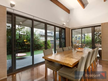 Modern dining room idea with hardwood & exposed eaves - Dining Room Photo 7404641