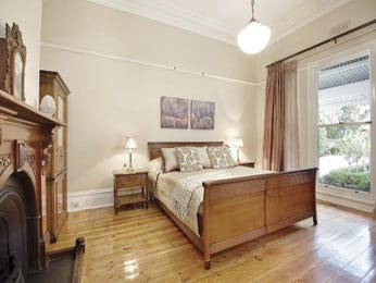 Classic bedroom design idea with floorboards & mantelpiece using brown colours - Bedroom photo 501661