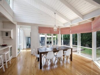 Modern dining room idea with floorboards & exposed eaves - Dining Room Photo 1195208