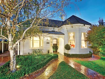 Concrete queen anne house exterior with porch & hedging - House Facade photo 467808