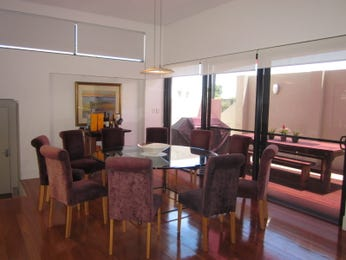 Modern dining room idea with floorboards & floor-to-ceiling windows - Dining Room Photo 139251