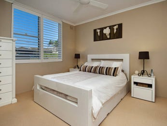 Modern bedroom design idea with glass & louvre windows using beige colours - Bedroom photo 441664