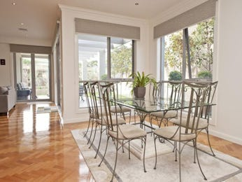 Modern dining room idea with floorboards & floor-to-ceiling windows - Dining Room Photo 1107983