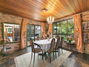 Classic dining room idea with exposed brick & exposed eaves - Dining Room Photo 7612621