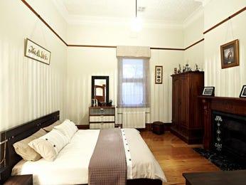 Classic bedroom design idea with hardwood & built-in wardrobe using brown colours - Bedroom photo 144521