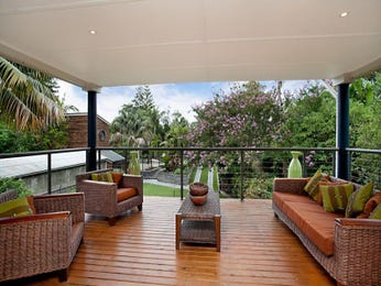 Landscaped garden design using timber with deck & outdoor furniture setting - Gardens photo 145059