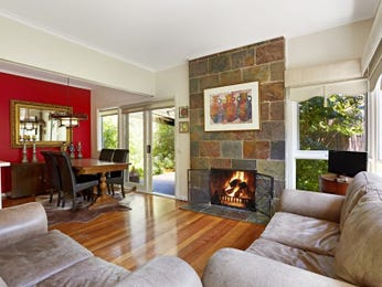 Dining-living living room using red colours with slate & fireplace - Living Area photo 7261777