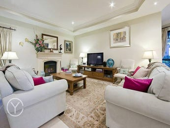 Open plan living room using neutral colours with carpet & fireplace - Living Area photo 477551