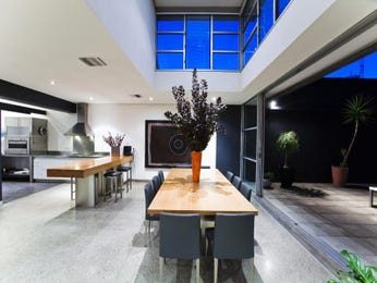 Modern dining room idea with polished concrete & bi-fold doors - Dining Room Photo 452599