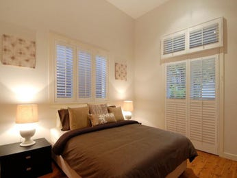 Modern bedroom design idea with wood panelling & bi-fold windows using beige colours - Bedroom photo 149300