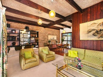Open plan living room using green colours with exposed brick & exposed eaves - Living Area photo 7863185