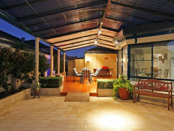 Multi-level outdoor living design with bbq area & hedging using tiles - Outdoor Living Photo 486792