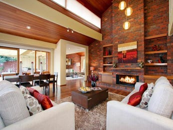 Dining-living living room using brown colours with exposed brick & built-in shelving - Living Area photo 368704