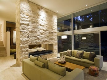Open plan living room using green colours with stone & fireplace - Living Area photo 17278577