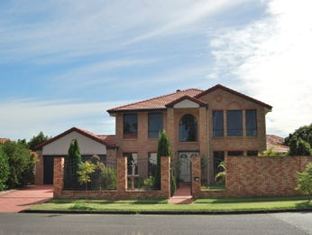 Brick modern house exterior with brick fence & hedging - House Facade photo 470086