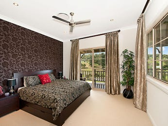 Retro bedroom design idea with floorboards & louvre windows using brown colours - Bedroom photo 204559