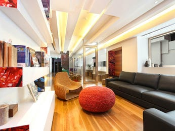 Open plan living room using red colours with floorboards & built-in shelving - Living Area photo 8258161