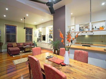 Art deco dining room idea with hardwood & ceiling skylight - Dining Room Photo 204734