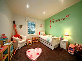 Children's room bedroom design idea with hardwood & built-in desk using brown colours - Bedroom photo 432251