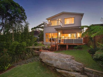 Landscaped garden design using grass with deck & rockery - Gardens photo 206980