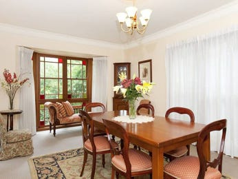 Formal dining room idea with carpet & bay windows - Dining Room Photo 389612
