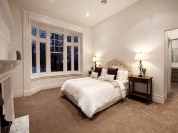 Classic bedroom design idea with carpet & fireplace using beige colours - Bedroom photo 208322