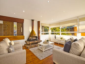 Open plan living room using beige colours with floorboards & fireplace - Living Area photo 15360741