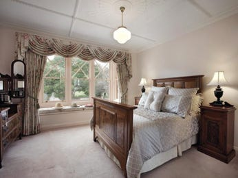 Classic bedroom design idea with carpet & sash windows using brown colours - Bedroom photo 209465