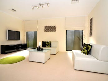 Open plan living room using yellow colours with carpet & bay windows - Living Area photo 209776