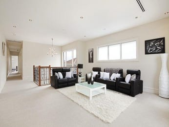 Open plan living room using silver colours with carpet & bay windows - Living Area photo 411531