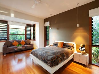 Modern bedroom design idea with hardwood & floor-to-ceiling windows using brown colours - Bedroom photo 474173