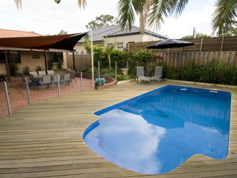 In-ground pool design using brick with cabana & hedging - Pool photo 443936
