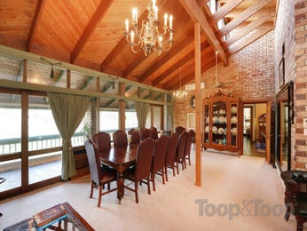 Classic dining room idea with exposed brick & exposed eaves - Dining Room Photo 8171805