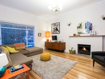 Open plan living room using beige colours with floorboards & fireplace - Living Area photo 2305813