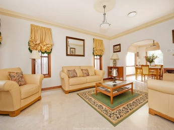 Dining-living living room using brown colours with carpet & louvre windows - Living Area photo 407752