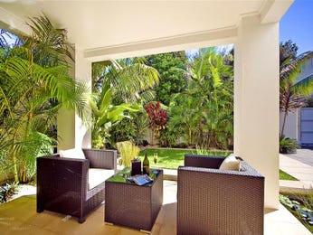 Landscaped garden design using grass with fish pond & outdoor furniture setting - Gardens photo 211839