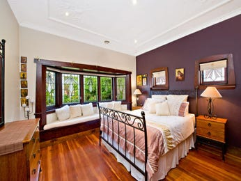 Modern bedroom design idea with hardwood & bi-fold windows using black colours - Bedroom photo 211873