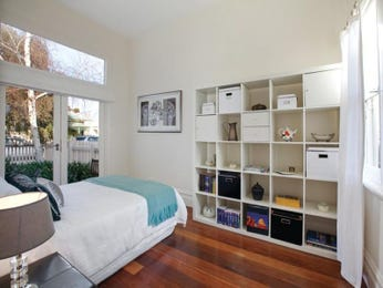 Classic bedroom design idea with floorboards & built-in shelving using white colours - Bedroom photo 211964