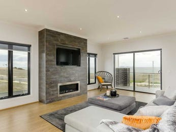 Open plan living room using grey colours with stone & fireplace - Living Area photo 8032657