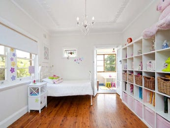 Children's room bedroom design idea with floorboards & built-in shelving using white colours - Bedroom photo 212935
