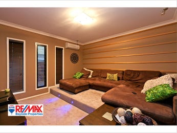 Split-level living room using beige colours with carpet & bay windows - Living Area photo 797484