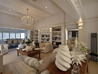 Open plan living room using beige colours with carpet & built-in shelving - Living Area photo 260724
