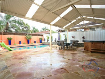 In-ground pool design using brick with decking & hedging - Pool photo 803922