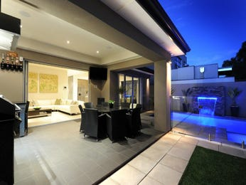 Indoor-outdoor outdoor living design with bbq area & fountain using stone - Outdoor Living Photo 262391
